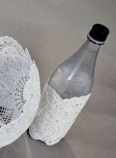 DIY with wallpaper paste: a doily on a balloon to make a bowl and around a plastic bottle for a jar. Has to dry for one day. See the results: http://formelledesign.blogspot.com/2012/01/dukar-och-tapetklister.html