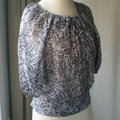"""Anthropologie top. Edme & Esyllte. Size 4. Beautiful grey/tan floral peasant top. Only wore it a couple times and in excellent condition. Size 4. Sz small. Cropped sleeves, tie in front, 3 buttons at side (hip). Laying flat: 11"""" armpit to hem, 20.5"""" shoulder to hem, 20"""" armpit to armpit, 19.5"""" back of neck at center to hem. These are appx measurements because the blouse is a loose fit. 100% cotton. Machine wash. Anthropologie Tops Blouses"""