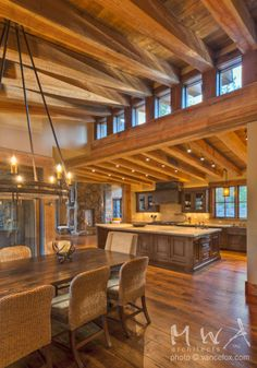 Exposed heavy timber beams with wood ceiling at high and low shed roof forms. Clerestory windows.