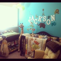 Love the animals by the child's name.  Room has a little too much going on though.