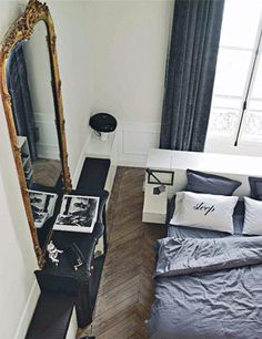 high ceilings, gilt mirror, minimalist bedroom