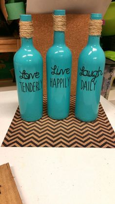 Wine bottles I painted with spray paint and Used My Cricut for the letters. Spray Adhesive and spray Polyethylene @VinoPlease #VinoPlease