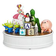 Toy Story Group Figurine by Derek Lesinski | Disney Store Your favorite friends from Disney's <i>Toy Story</i> gather together on this beautiful figurine, designed by Derek Lesinski. Much like Andy's toys, this collectors peice truly comes to life with intricate accents and vibrant detailing.