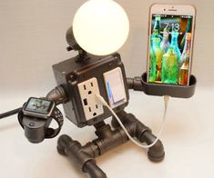 Steampunk Industrial Robot Pipe Desk Lamp with Dimmer, 2 AC & 2 USB outlets, Smartphone Charging Cradle, optional Apple Watch Charger AirBnB – Top Trend – Decor – Life Style Industrial Pipe Desk, Industrial Robots, Metal Projects, Welding Projects, Diy Lampe, Steampunk Lamp, Pipe Lamp, Pipe Furniture, Metal Art