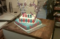 5th grade graduation cake~Snickers and Reece's 2 tier cake with homemade marshmallow fondant and hand-cut lettering and argyle design! My first fondant cake! Turned out great!!!~Diane