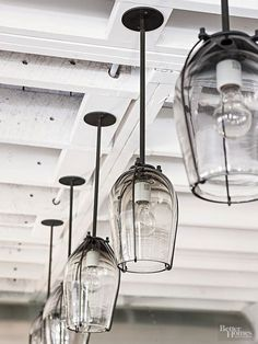 The glass housings for these light fixtures are perfect pretty pendants that are great for illuminating your kitchen island.