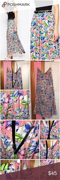 """Madam Rage Floral Maxi Skirt Worn once and has been washed. Madam Rage from ASOS. Smooth woven fabric. Says 14 on the tag BUT that's UK sizing. This IS a US 10. All over floral print. Loose fit (falls loosely over the body.) Side zipper. Comes with belt but the belt isn't the best quality. 100% polyester. Approx 33"""" waist and approx 41.5 in length. Model in stock photo is 5'8.5"""" tall. ❌NO TRADES❌ ASOS Skirts Maxi"""