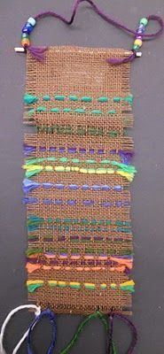First, students removed strips of burlap on all sides to create fringe. To create a space to weave, students removed two strings of burlap. Then, they used plastic needles to weave their yarn (the weft) over and under the warp. I glued small dowel r Classe D'art, 2nd Grade Art, Grade 3, Weaving Projects, Art Projects, Weaving Textiles, Art Lessons Elementary, Art Lesson Plans, Art Classroom