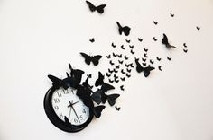 """DIY """"time flies"""" butterfly clock- It reminds me of the thing behind Serena's bed on Gossip Girl."""