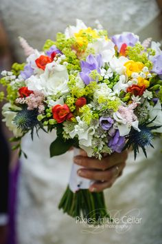 Colourful wedding bouquet with freesias