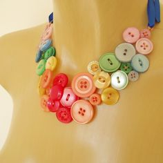 Rainbow button necklace.  The buttons are held in place with wires.  Very cute!