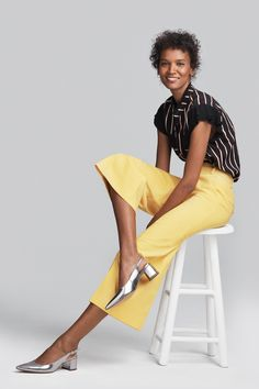 Bring a little sunshine to your style with Filippa K's zesty lemon culottes. We love how Liya Kebede wears hers with shimmering silver slingbacks in our spring summer '17 campaign. Marc Cain Collections Blouse; Filippa K Culottes; Högl Slingbacks