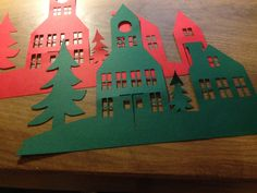 I resized these ones and cut them in red and green. When they're bigger, it's also easier to cut the windows.