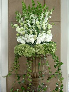 beautiful formal container gardening, this is just breath taking to me! obviously these are cut flowers for a special occasion, but could do something similar for annuals with variegated vinca, white petunias, foxglove, or other tall white flower.
