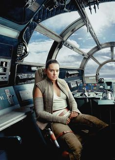 Rey in the pilot's seat of the Millennium Falcon