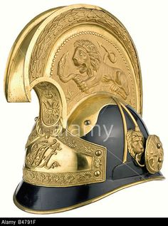 A helmet for a cuirassier officer, circa 1848/1850. Skull is of zinc-plated sheet iron with exterior black lacquer, gilded furn Stock Photo