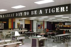 Spice Things Up In Your School Cafeteria - Carroll Seating Company School Cafeteria Decorations, School Hallway Decorations, School Entrance, School Hallways, School Murals, Hallway Ideas, Hallway Decorating, School Lunchroom, Cafeteria Design