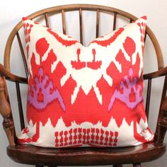 Quadrille Kazak Ikat pillow cover in Orange and Magenta Tissue paper flowers for drama. This is simple, beautiful, dramatic, inex. Living Room And Dining Room Design, Living Spaces, Color Patterns, Print Patterns, Ikat Pillows, Cushions, Apartment Makeover, Tissue Paper Flowers, Ikat Print