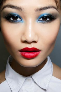 Embrace pops of color with your eye makeup with a matte red pout. It's blue, it's bold and it's beautiful.
