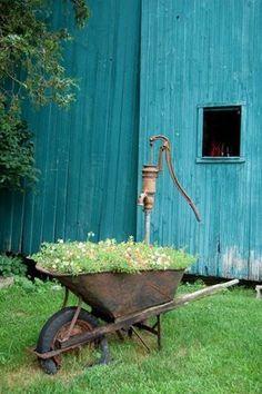 I have an old wheelbarrow in my garden....love it!