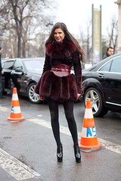 Paris Street Style Couture 2013. A bold corset belt gives an ultra-femme shape to a richly-hued burgundy fox fur.