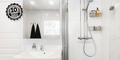 Valkoinen kylpyhuone ja tilava sauna │ Laattapiste #kylpyhuone #valkoinen #laatta #kylpyhuoneremontti Bathroom Medicine Cabinet, Cabinet, Bathroom, Bathroom Hooks, Bathtub
