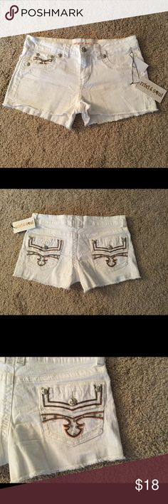 """NEW White Denim Shorts with decorative pockets Very cute white denim shorts with front button and zipper closure. False pockets in front and 2 pockets in back. Frayed hemline (see photos). Belt loops. Inseam 2"""". Front rise 8 1/2"""". This is a NWT never before worn item. 99% cotton, 1% spandex. Easy care. Machine wash and tumble dry. Back decorative pockets with buttons and rhinestones. Thanks for visiting my closet! rebel & soul Shorts"""