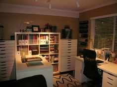 Beautiful craft room with Ikea furniture (Expedit, Alex, Vika) and Bygel rails mounted on the wall for punches. Love, love love it!