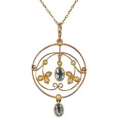 """""""The Derrymore Pendant from Brilliant Earth Concentric circles and delicate scrolls of yellow gold add depth and beauty to this Victorian pendant, which showcases two mesmerizing aquamarine gemstones and eleven romantic cultured pearl accents Date: 1880's"""" (quote)"""