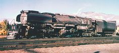 Union Pacific Challenger type 4-6+6-4 steam locomotive # 3717, is seen in the yard at Ogden, Utah, 04-10-1959