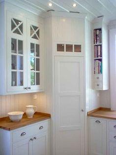 Corner pantry in White, scandinavian kitchen. I love the narrow shelves for book. Corner pantry in Home Kitchens, Corner Pantry Cabinet, Corner Kitchen Pantry, Scandinavian Kitchen, Kitchen Design, Corner Cupboard, Corner Kitchen Cabinet, Pantry Design, Kitchen Cabinets