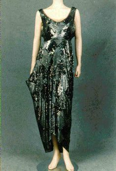 1912 -. Silk, sequins.I can't help but bring Sarah's mother back for a moment,because she had a dress like this,and we still have it! Her clothes were pretty awesome!