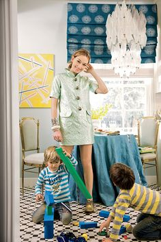 how to decorate with patterns on domino.com --  table, tablecloth, chairs & rug!!!!!!!!!!!!!1  great roman shade on window.