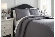 The singular, sensational color of the Raleda coverlet set is given just enough oomph care of stylish hand-stitched ribbing. Rest assured, less can be so much more. Comforting to know it's machine washable, too. King Comforter Sets, Queen Size Bedding, Bedding Sets, King Size Coverlets, Navy Bedding, Ashley Home, King Pillows, Pillow Shams, White Furniture