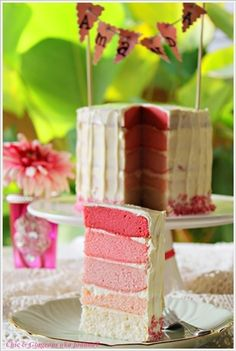 Pennant banner on pink ombre cake