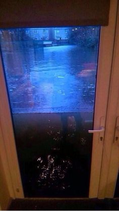 Somerset Floods, UK, Jan &Feb 2014. Notice the water coming through the key holes. Scary