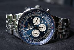 Our friends at Breitling have something of the perfect fit here.. Navitimer Heritage.  The band is a subtle silver, nicely polished.. the face is a perfect play on the shirt worn by RG.  I'm liking this a lot.