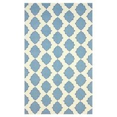 """Hand-hooked wool rug with a quatrefoil-inspired motif.  Product: RugConstruction Material: 100% WoolColor: Blue and ivoryFeatures: Hand-hooked Pile Height: 0.25"""" Note: Please be aware that actual colors may vary from those shown on your screen. Accent rugs may also not show the entire pattern that the corresponding area rugs have.Cleaning and Care: Spot treat with a mild detergent and water. Professional cleaning is recommended if necessary."""