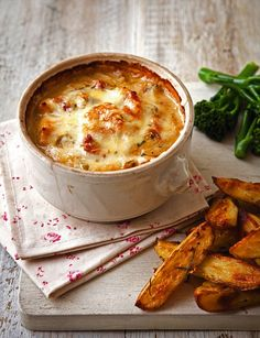 Chicken and tarragon pots with rosemary potato wedges- use Frylight and beware of how much cheese we use!
