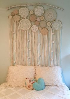 Custom made dreamcatcher wall hanging. Hand wrapped metal rings, with vintage doilies, vintage scarves, gold and lace ribbon, handmade pompoms, and cream and white fabric strips. Credit: @followyourdreamsshop ❤️  https://www.etsy.com/shop/Followyourdreamzshop?ref=seller-platform-mcnav