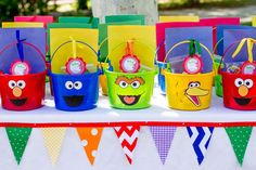 Favor buckets at a Sesame Street birthday party!   See more party planning ideas at CatchMyParty.com!
