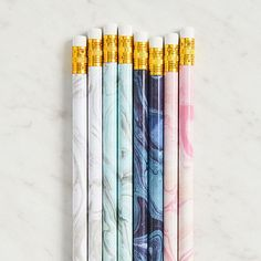 This gorgeous set of marbled pencils is a chic addition to any desk or office. Set of 8 pencils in 4 colors.