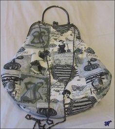 https://www.etsy.com/es/listing/223221449/bolso-con-boquilla-estilo-vintage