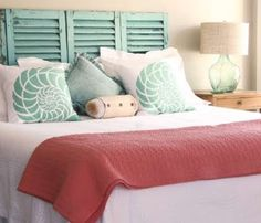 Turquoise shutter headboard and shell pillows: http://www.completely-coastal.com/2014/09/interior-decorating-with-shutters.html