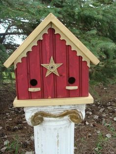 Red birdhouse with pedestal