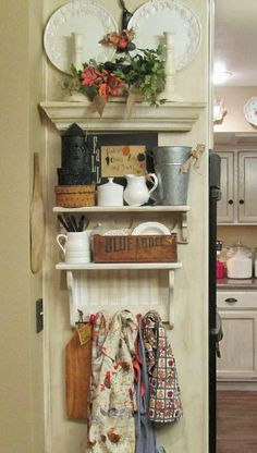 Love this way to decorate, store, and display! All in a tight spot that would've been wasted space!