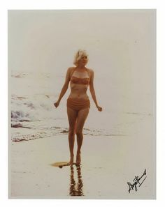 Marilyn on the beach. if only size 14 actually looked like this