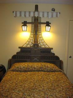 The beds have ship masts above the headboards and bedding decorated like a treasure chest of coins and jewels.
