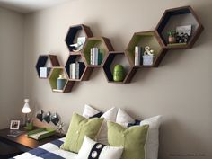 The shape and construction of these geometric bookshelves ensure it adapts to wall surfaces, easily bending around corners to put every inch to good use.