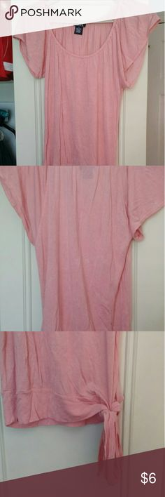 Pink Rue 21 Top Peach tee with a lower neckline and loose sleeves. A little see-through. Tie on the left side. Soft, thin fabric. Worn only a few times. No stains or tears. Closet closing 8/25/16 due to college Rue 21 Tops Tees - Short Sleeve